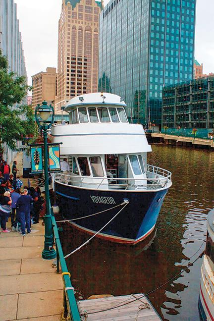 The Milwaukee Voyageur is docked on the Milwaukee River before the lakefront cruise.