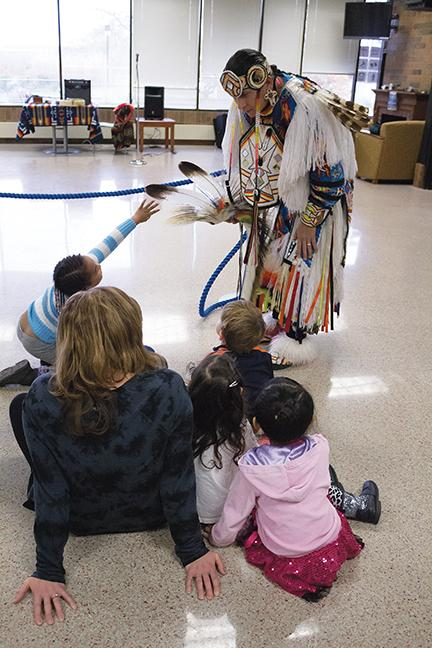 Allowing children to get close, showing that the feather is real.