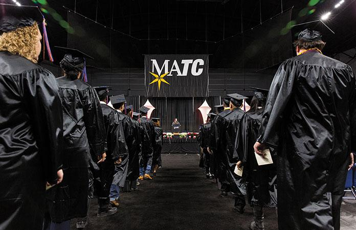 MATC+graduates+make+their+way+to+their+seats+in+UW-Milwaukee+Panther+Arena+during+the+college%E2%80%99s+winter+commencement+ceremony+on+Dec.+16.