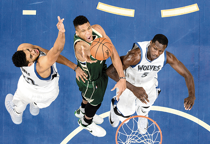 The+Milwaukee+Bucks%26apos%3B+Giannis+Antetokounmpo%2C+middle%2C+converts+a+layup+despite+pressure+from+the+Minnesota+Timberwolves%26apos%3B+Karl-Anthony+Towns%2C+left%2C+and+Gorgui+Dieng+in+the+first+half+on+Friday%2C+Dec.+30%2C+2016%2C+at+Target+Center+in+Minneapolis.+The+Timberwolves+won%2C+116-99.+%28Aaron+Lavinsky%2FMinneapolis+Star+Tribune%2FTNS%29