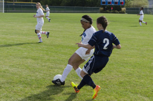 Women's team storms the soccer field