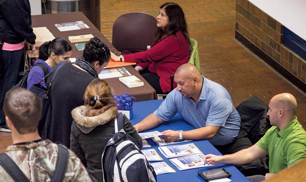 Concordia University Wisconsin advisers with potential students gathering information during Transfer Days at the Oak Creek campus on Oct. 17.