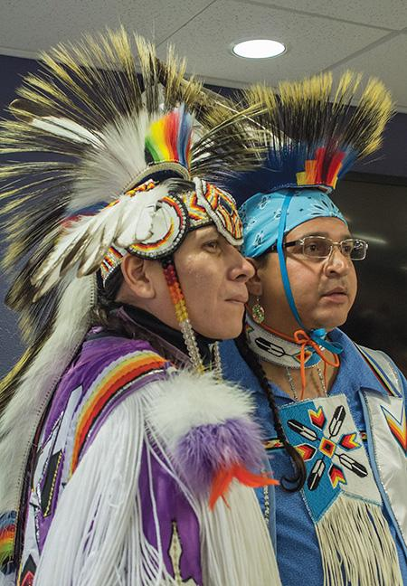 Ronnie Preston (left) and brother Daniel Preston (right) of the San Carlos Apache Tribe, display their regalia for the students of the West Allis Campus during their Native American dance demo on Oct. 19.