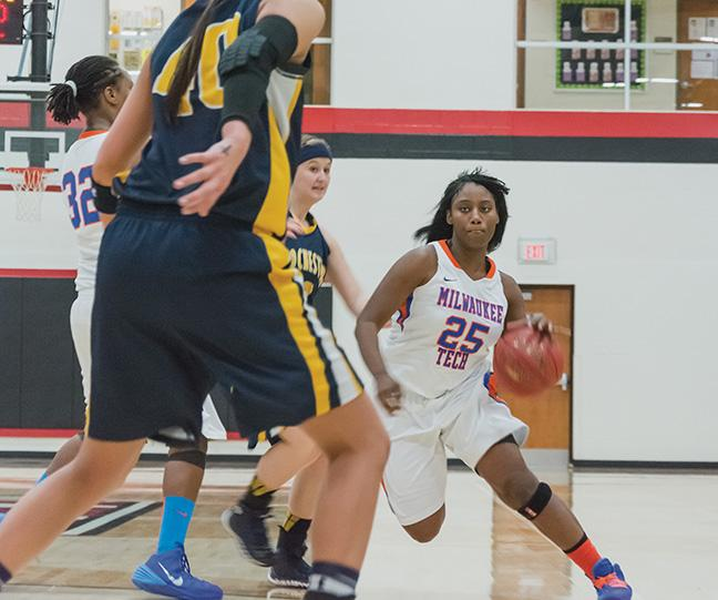 Ashley McHenry (25) drives down the court during a recent game against the Rochester Yellowjackets. The women won 97-66.