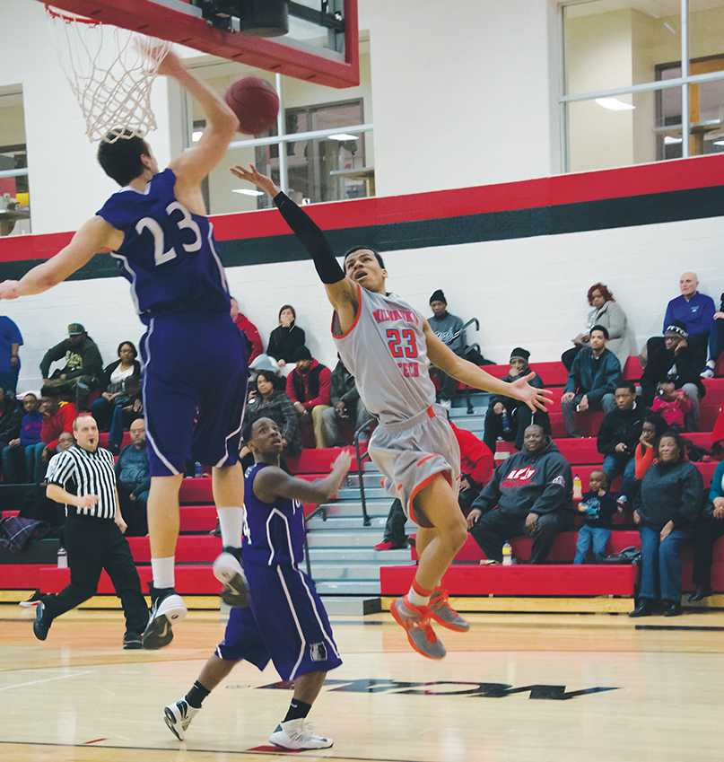During a competitive win (89-78) against the Harper College Hawks Arthell Rosquist (#23) goes for a difficult lay up and tries to finesse the ball past the defender.