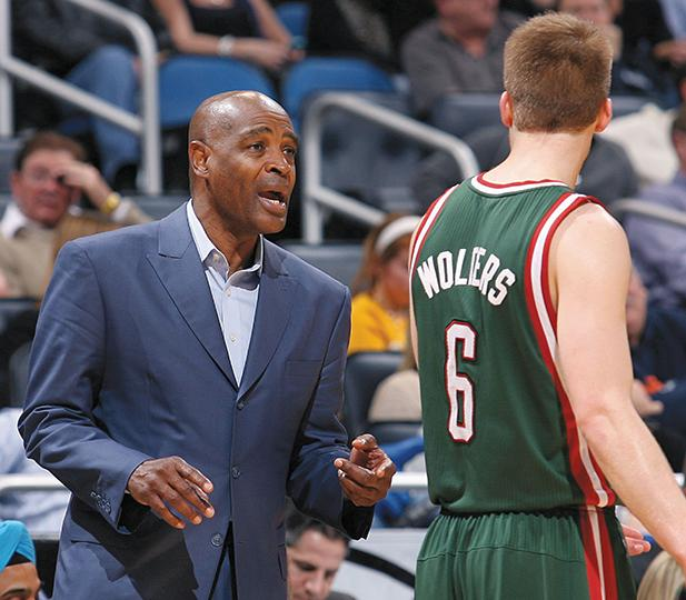 Milwaukee Bucks head coach Larry Drew, left, talks to guard Nate Wolters (6) during action against the Orlando Magic on Jan. 31.