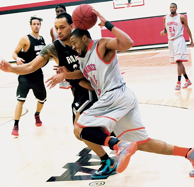 Freshman Terrell Hayes (34) drives to the basket, paving the way to victory against the Wilbur Wright College Rams.