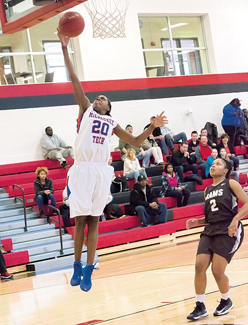 Shonnice Vaughn (20) scores an easy layup after a steal.