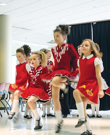 Irish dancers entertain the audience with their stunning choreography.
