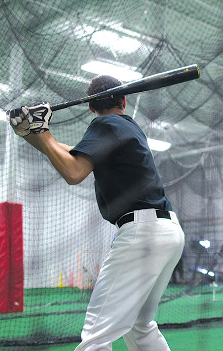One of the players from the Stormers practices hitting home runs in preparation for the start of the season.