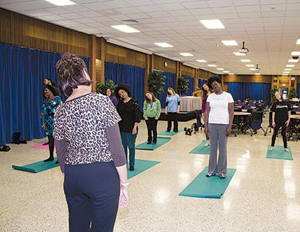 Students using meditation and stress relief techniques.