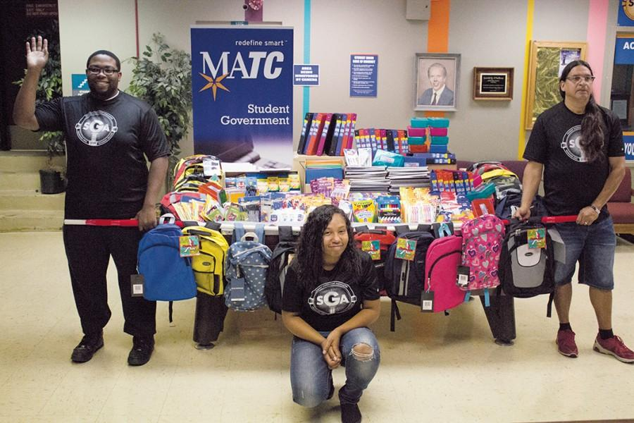 West Allis Student Government representatives, (L) Jarvis Harmon, Antoinette Jackson and Daniel Preston, displayed the vast amount of school supplies purchased with funds raised by the Student Government, which were presented to the Menominee Tribal School.
