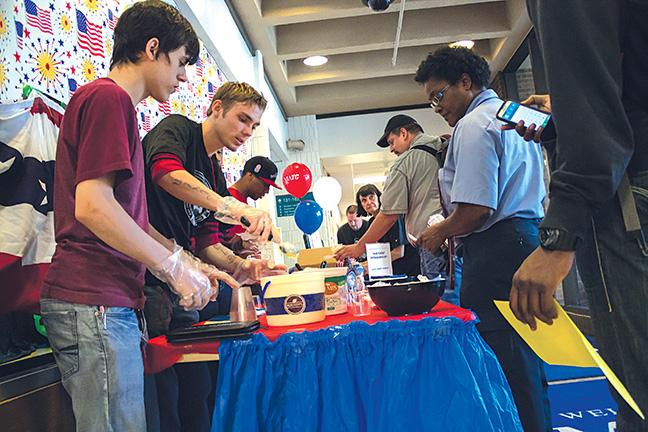 Max Gehrman (Welding program student), center, scoops up a delicious helping to other students as part of Student Government's Constitution Day. The event was a huge success in promoting awareness of our constitutional rights.