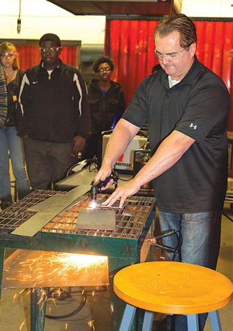 Jeff Ellingson, from local company Hypertherm, participates in the Heavy Metal event.
