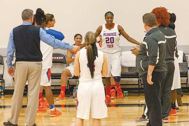 Shonnice Vaughn, guard, (#20) is back! Her teammates cheer her on during the opening ceremony of the game against UW-Whitewater.