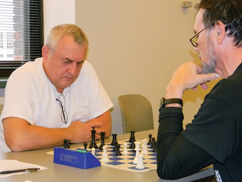 Volodymyr Opryshchenko battles Brian Spaeth, co-adviser for the Chess Club, for first prize in the chess tournament.