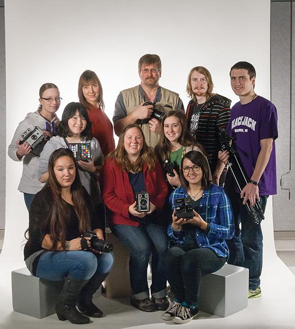 Members of the first Photography Club at MATC pose with photographic props.