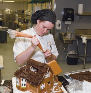 Hannah Antkowski, Baking and Pastry arts program, putting together her gingerbread house.