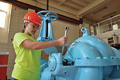 Allison Reichert gets hands-on training while learning about the water treatment operator maintenance.