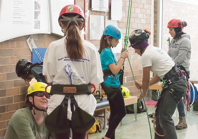 Girl Scouts get hooked up for a climb as part of the landscape horticulture program.