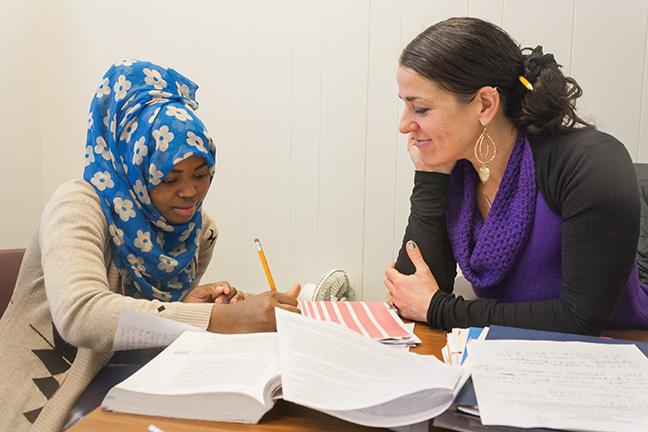 Early Childhood Education student Nimo Abdi (L) receives tutoring help from Educational Assistant Elizabeth Miller at the Office of Bilingual Education in M224 at the Downtown Milwaukee campus.