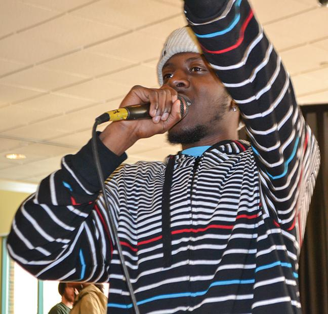A+performer+entertains+the+crowd+at+the+BSU%E2%80%99s+Open+Mic+event+on+Feb.+25.