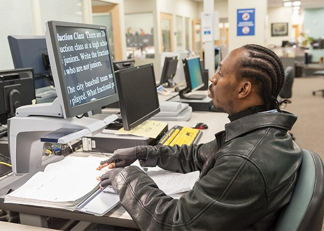Ozzie Burt, Physical Therapy Assistant program, works on his pre-algebra homework in the Student Accommodations Office.