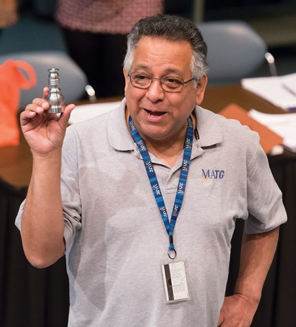 John Lopez, Student Services specialist, shows a chess piece that students will make as part of their training for the Machine Tooling program at the information session on March 10.