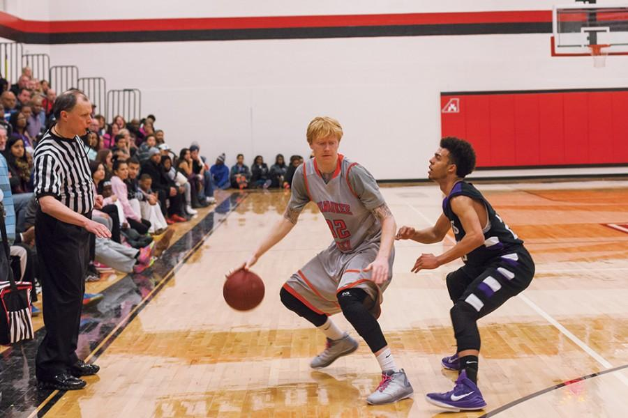 Kevin Kellner (#32) attempts to work the ball inside the 3-point line by backing down the opposing Joliet player.