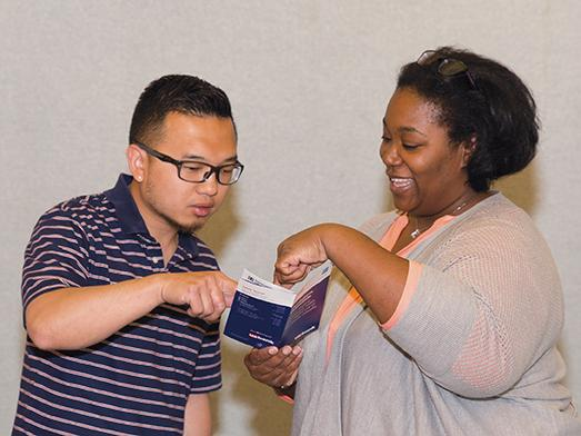 Michael Yang, student in the Human Resources program, gets financial information from Stephanie Knox, assistant manager at U.S. Bank, MATC branch, during the U.S. Bank's Financial Literacy Workshop on June 17.