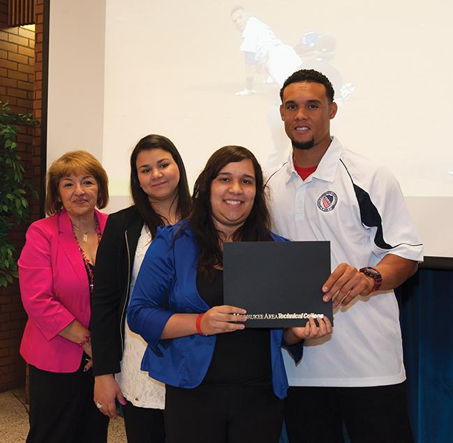 League of United Latin American Citizens (LULAC) president Fela Salinas, Gerandy Gomez, Carlos Gomez award Ivonne Rosado, Nursing program a scholarship.