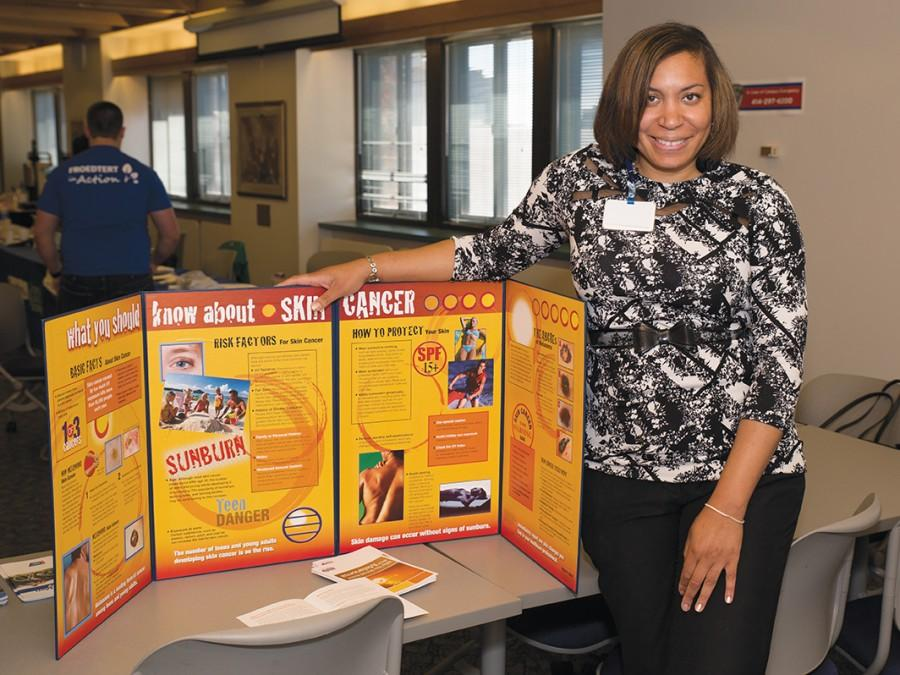 Janine+Tucker%2C+outreach+coordinator+of+Froedert+Hospital%2C+stands+by+a+message+board+and+gives+information+about+skin+cancer+during+the+MATC%E2%80%99s+Men%E2%80%99s+Health+Awareness+Month+at+the+Downtown+Milwaukee+campus+on+June+16.