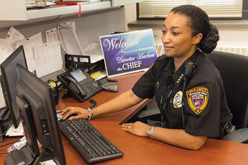The new Director of Public Safety, Chief Aisha Barkow, sits at her desk at the Main Building at the Downtown Milwaukee campus.