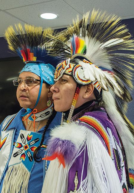Ronnie Preston (left) and brother Daniel Preston (right) of the San Carlos Apache Tribe, display their regalia for the students of the West Allis campus during their Native American dance demonstration.
