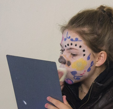 """Koryn Warren of West Allis applies her """"Muertos"""" makeup."""