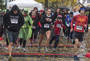 """Runners brave the cold and rain as they take off for the """"Day of the Dead"""" 5-kilometer run."""