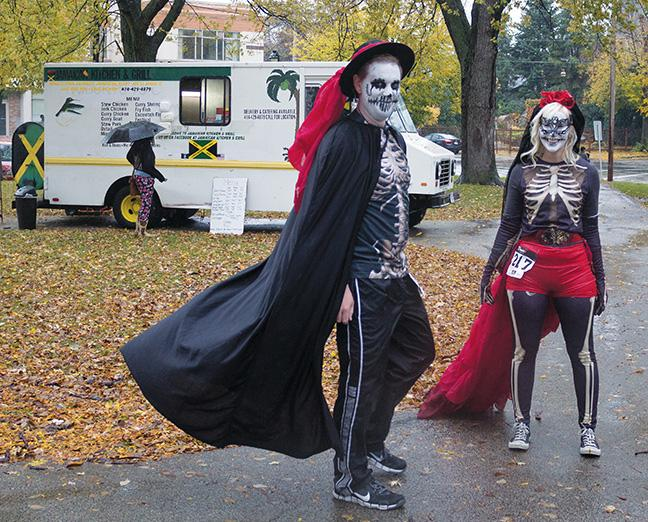 """Participants in their traditional """"Muertos"""" costumes and makeup."""