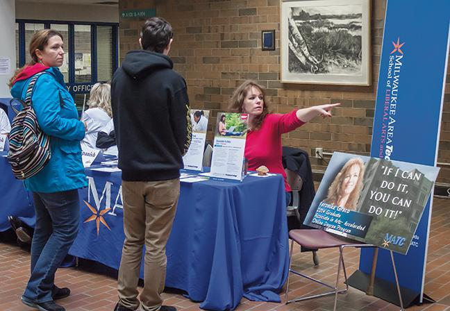 Associate in Arts accelerated program graduate Veronika Greco (L) gives potential students advice at the Oak Creek campus Open House on Oct. 17.