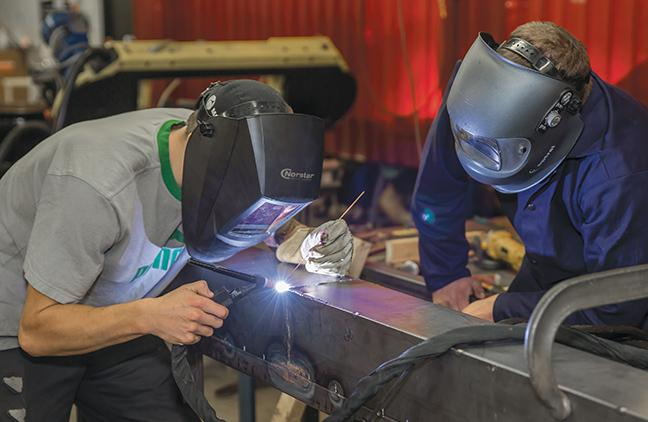 Working+on+the+second+frame+of+the+project+is+Devin+Schroeder+%28L%29+and+Adam+Blaeske%2C+both+with+the+Welding+program.+Schroeder+is+TIG+welding+the+frame+while+Blaeske+is+observing+his+technique.