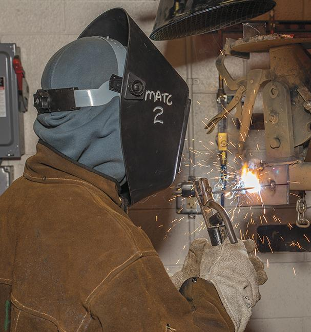 Derek Gross, Welding program student, practices his stick welding technique at the welding shop at the MATC Oak Creek campus.