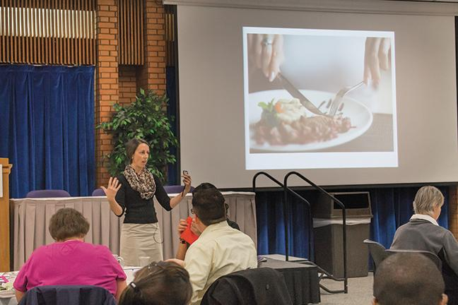Lynnette Zimmerman from Essential Details gives a speech at the downtown Milwaukee campus on Jan. 29 about how to use the proper etiquette when hosting a dinner.