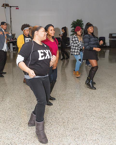 """Students hit the dance floor at the downtown Milwaukee campus' """"Winter Jam"""" on Jan. 29. They enjoyed the sounds of Dr. B and DJ Grandmaster O. The event was sponsored by the downtown Milwaukee campus Student Government."""