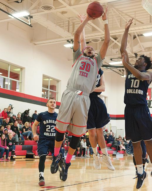 "Austin ""A-Ball"" Dunbar (30) goes up for a slam dunk."