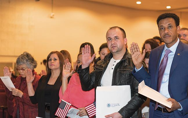 New citizens take the oath of the United States.