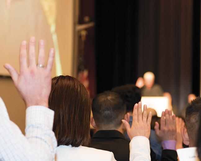United States Magistrate Judge William E. Dufffin leads new citizens swearing an oath to the United States of America.