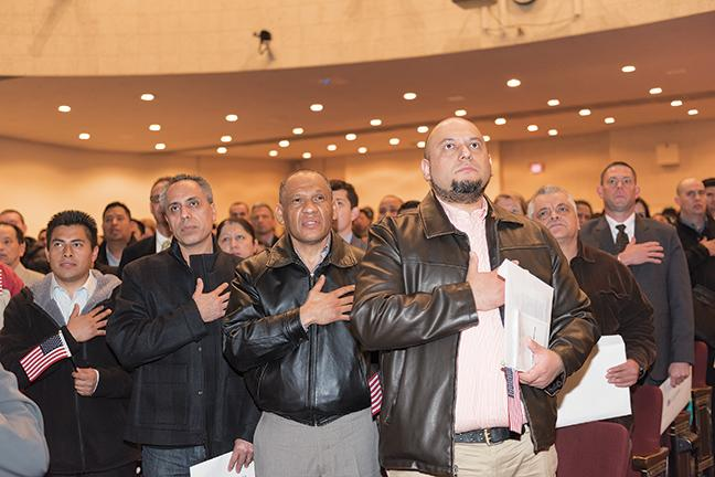 Newly sworn in US citizens say the pledge of allegiance.