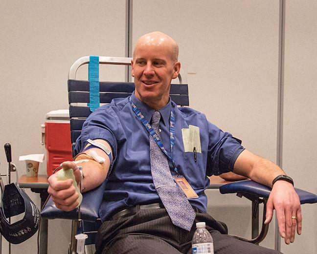 Instructor+Doug+Braun+gives+the+gift+of+blood+at+the+second+annual+blood+drive+at+the+Oak+Creek+Campus.+