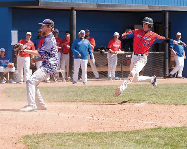 As the catcher chases down a passed ball, Fred Brower (19) runs home to score the winning run for the Stormers, 8-7 against the Wolves in the first game of doubleheader on April 16.