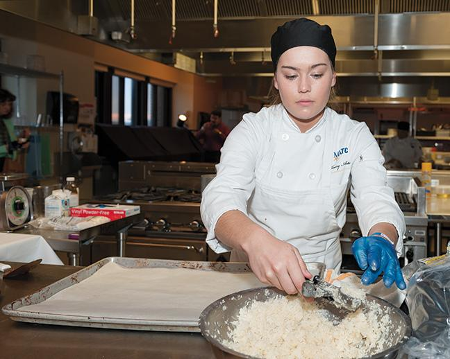 Samantha Weber, Culinary Arts program, prepares rice for a dish at the French station.