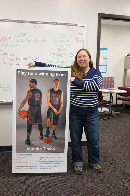 Kirsten Schmitt, Photography program student, stands next to a recruitment poster with her image used by the MATC Times.